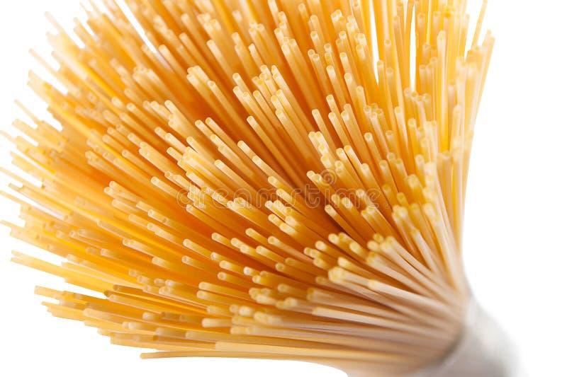 Wholegrain spaghetti makaron odizolowywający na bielu zdjęcia stock