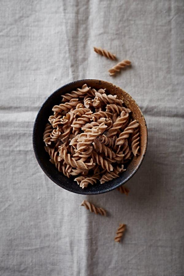 Wholegrain spelt pasta in a ceramic bowl organic pasta stock photos