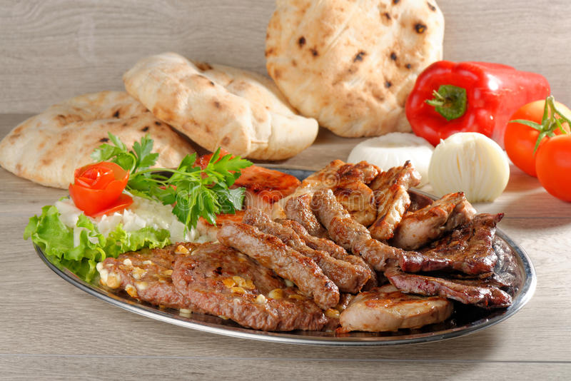 Wholesome platter of mixed meats, Balkan food. Wholesome platter of mixed meats including grilled steak stock photos