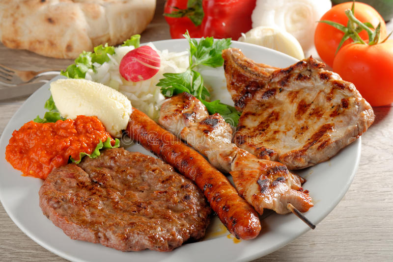 Wholesome platter of mixed meats, Balkan food royalty free stock photos