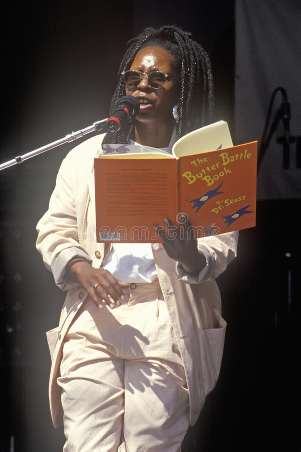 Whoopi Goldberg reads Dr. Seuss to kids at the Rainforest Benefit, Greek Theater, Los Angeles, California stock photography