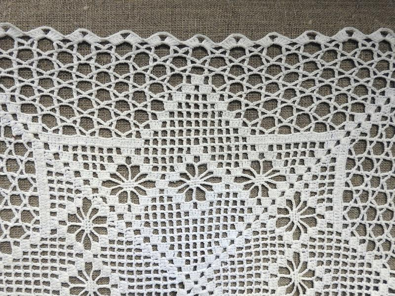 Whte crochet tidy on brown background royalty free stock photo