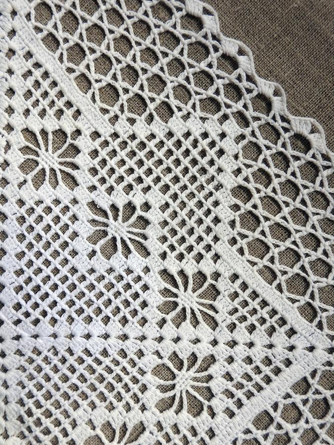 Whte crochet tidy on brown background royalty free stock images