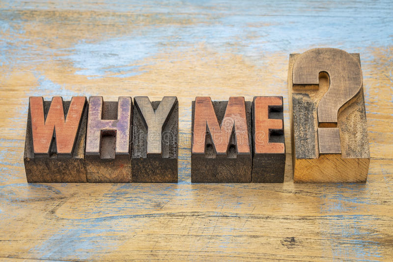 Why me question in letterpress wood type. Why me question - text in vintage letterpress wood type blocks stained by color inks stock photos