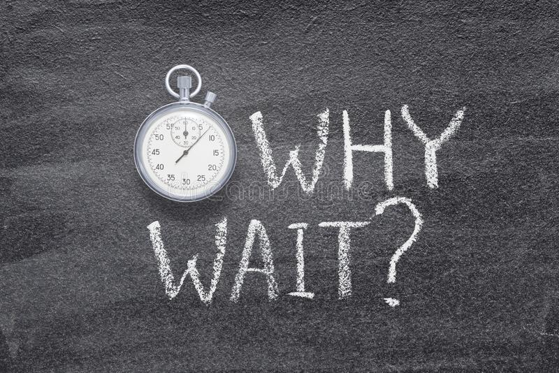 Why wait watch. Why wait question written on chalkboard with vintage precise stopwatch royalty free stock image