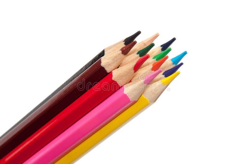 Wiązka drewniani barwioni ołówki nad białym tłem zdjęcie stock