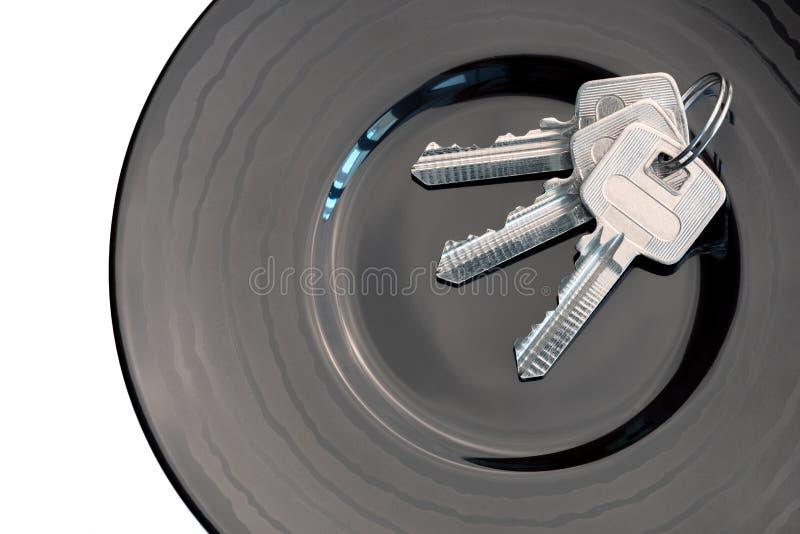 Wiązka klucze w czarnym sauser fotografia royalty free