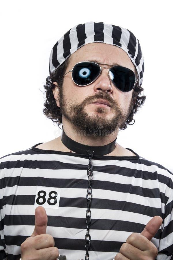 Więzienie, jeden caucasian mężczyzna więźnia przestępca z łańcuszkową piłką i zdjęcia royalty free