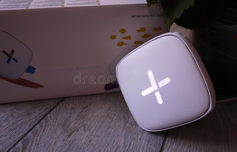 Wi-Fi adapter for home in a beautiful interior. Used to distribute the Internet at home royalty free stock photography