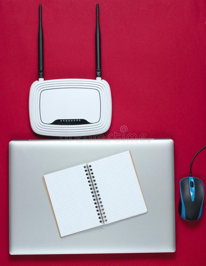 Wi fi router, laptop, pc mouse, notepad royalty free stock photography