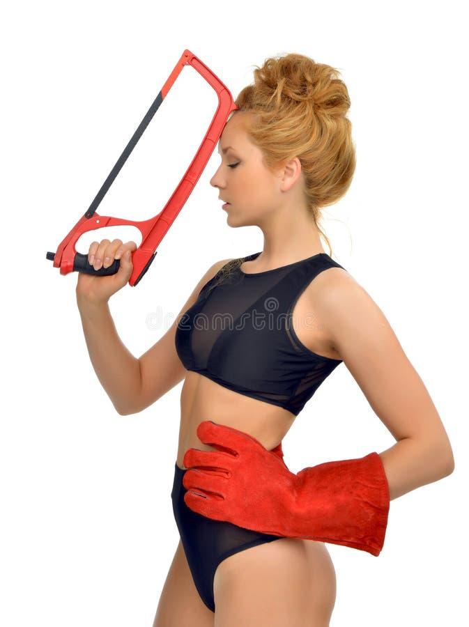 Wi vermelhos novos 'sexy' da cara do trabalhador do contratante de construção da mulher do cabelo foto de stock