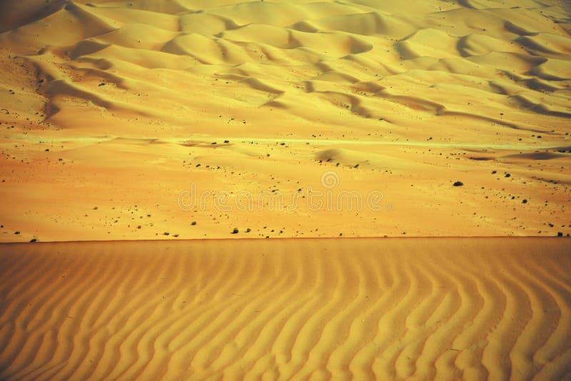 Wiatr tworzył wzory w piasek diunach Liwa oaza, Zjednoczone Emiraty Arabskie zdjęcie royalty free