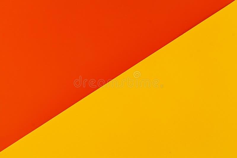 Wibrująca pomarańcze i żółte barwione klingeryt powierzchnie spajający diagonally, tło zdjęcia royalty free