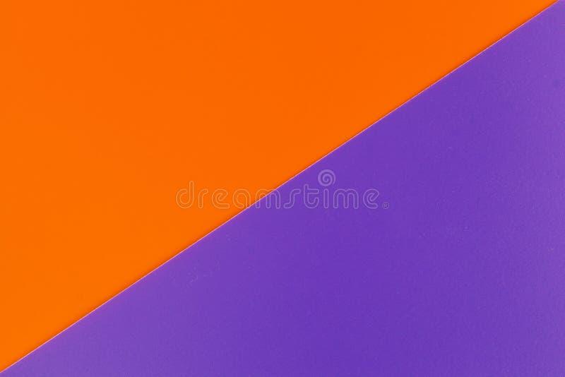 Wibrująca pomarańcze i purpurowe barwione klingeryt powierzchnie spajający diagonally, tło fotografia royalty free