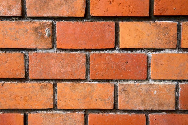 Wibrujący ściany z cegieł fotografii tło Pomarańczowy brickwork zbliżenie r Pomarańczowy ceglany brukowanie obraz royalty free