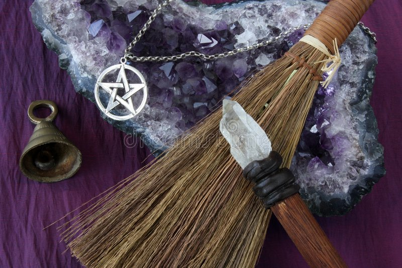 Wiccan Objects. Close up of wiccan objects - pentacle pendant, wood / crystal wand and straw besom stock photography