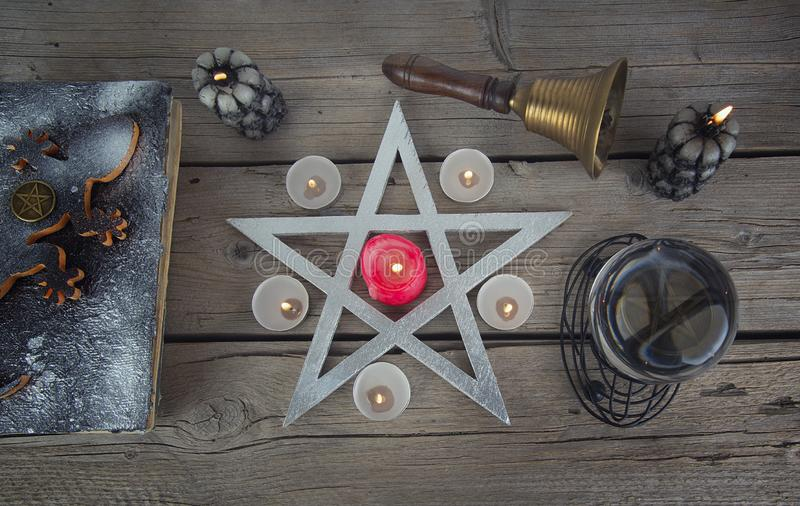 Wiccan symbols for divination ritual. Crystal ball and pentagram stock photo