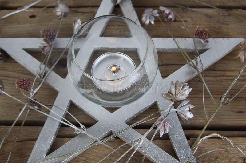 Wiccan symbols for divination ritual. Crystal ball and pentagram stock images