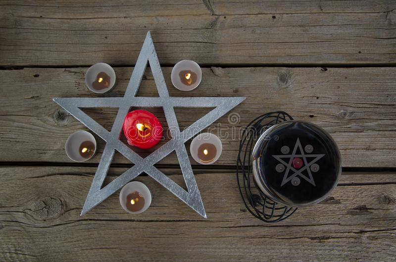 Wiccan symbols for divination ritual. Crystal ball and pentagram stock image