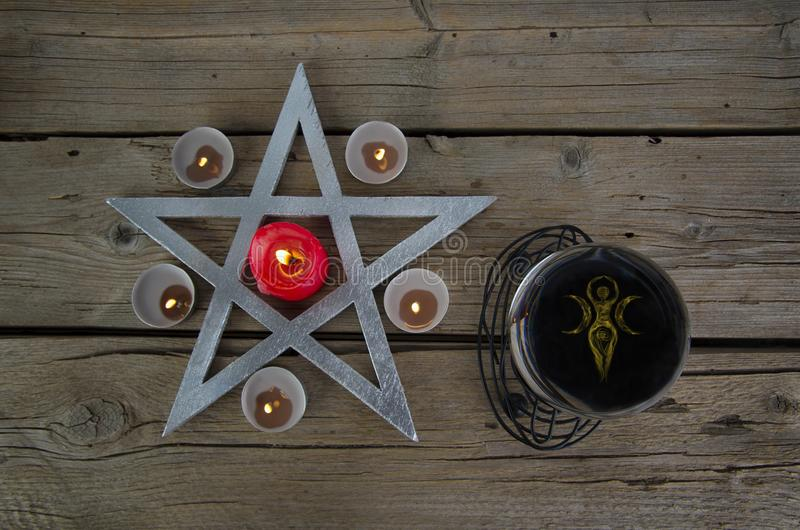 Wiccan symbols for divination ritual. Crystal ball and pentagram royalty free stock photos