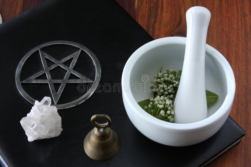 Wiccan Tools. Closeup of wicca spell tools and book of shadows with mortar and pestle stock photos