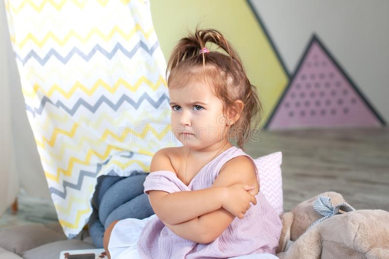 Wicked little girl. Concept sign and gesture, emotion. Upset little girl. concept of anger, disappointment and harm, copy space. l royalty free stock photos