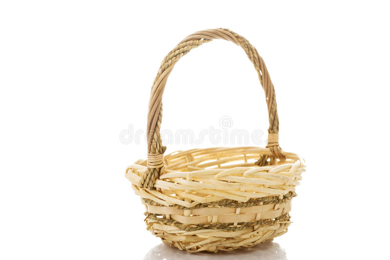 Wicker basket. On white royalty free stock images