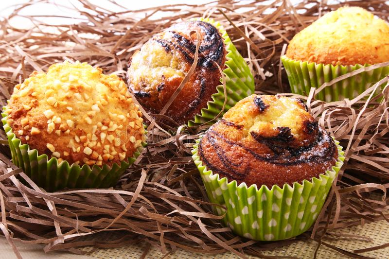 Wicker basket with assorted delicious homemade cupcakes with raisins and chocolate. Cupcakes. Top View. Copy space. royalty free stock image
