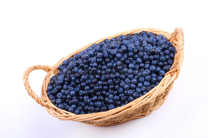 Wicker basket with blueberries stock images