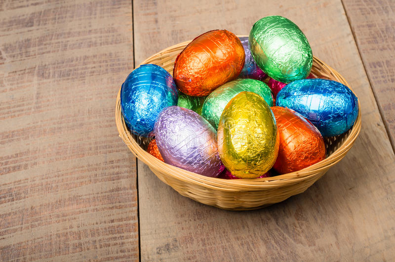 Wicker Basket With Chocolate Eggs Royalty Free Stock Photo