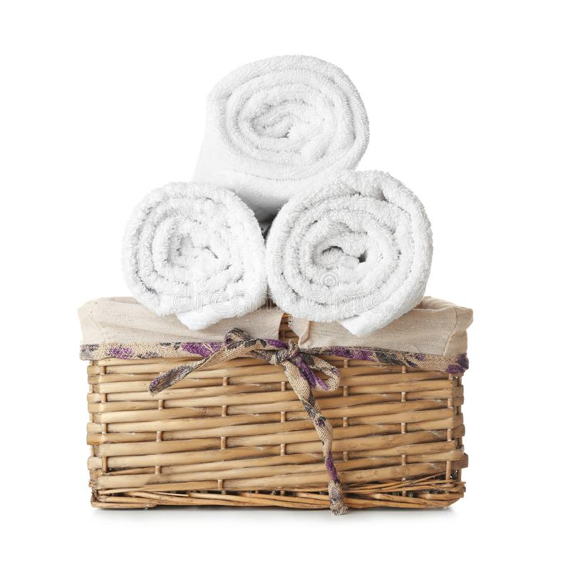 Wicker basket with clean rolled towels on white background royalty free stock image