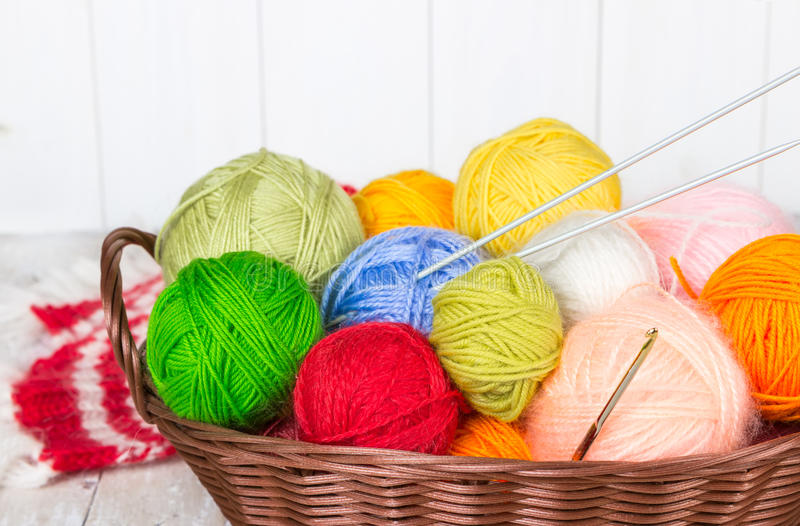 Wicker basket with colorful balls of yarn royalty free stock photography
