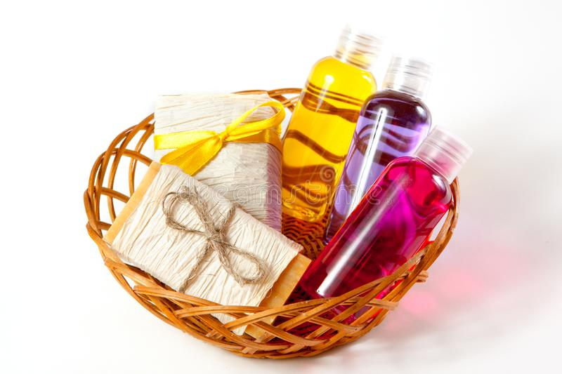 Wicker basket with cosmetic body care products stock photos