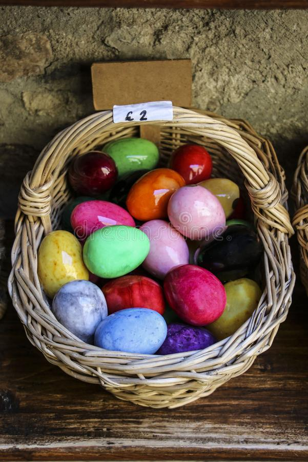 Wicker basket with Easter eggs of different colors royalty free stock photos