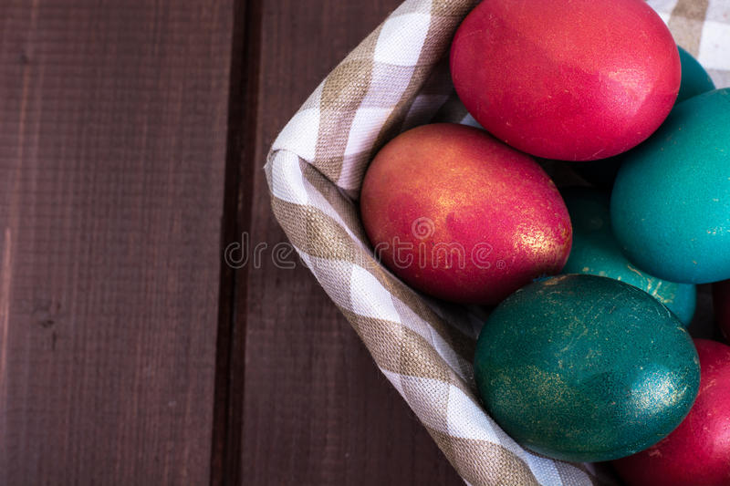 Wicker basket with Easter symbols royalty free stock images