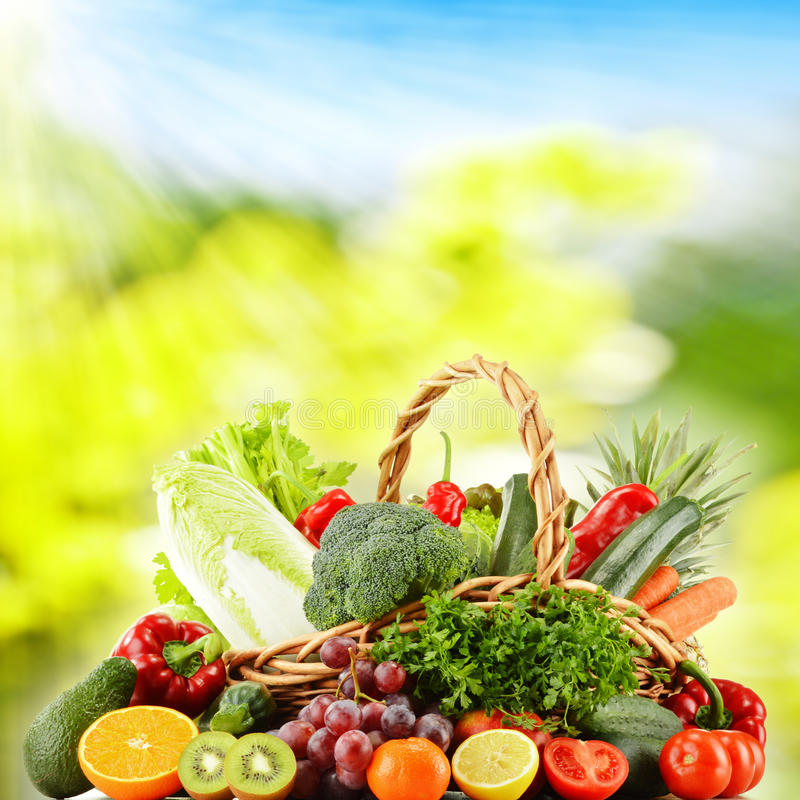 Wicker basket with groceries. Dieting and detox stock image