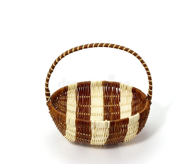Wicker basket of natural materials on a white background folk crafts royalty free stock images