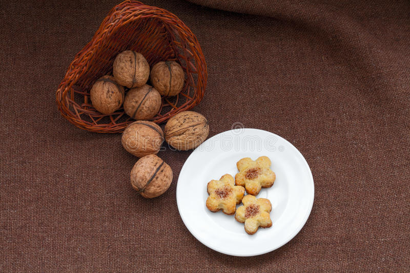 Wicker basket with nuts and pastry on a plate. See my other works in portfolio royalty free stock photos