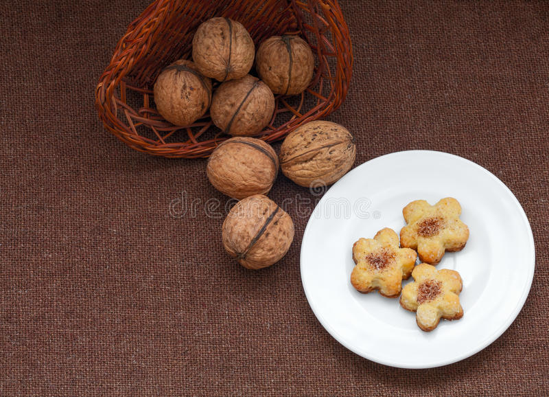 Wicker basket with nuts and pastry on a plate. See my other works in portfolio royalty free stock photography