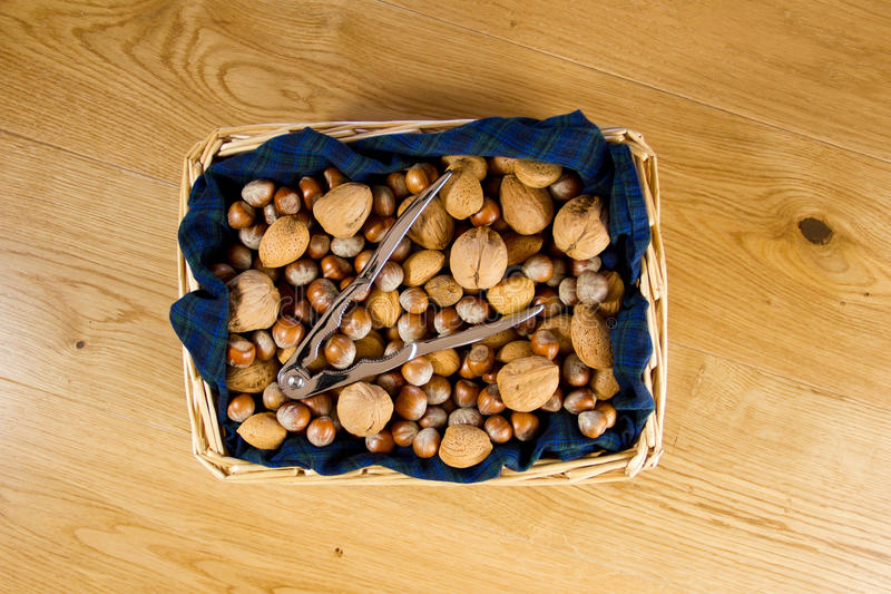 Download Wicker Basket Of Nuts On Tartan Stock Photo - Image: 28233336