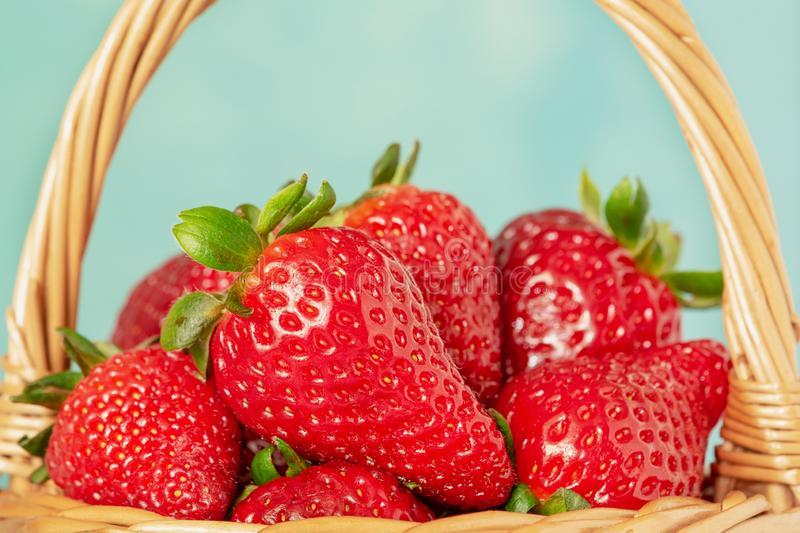 Wicker Basket with Strawberries Closeup Side View. Ripe Appetizing Spring Berries with Nutrient and Vitamins. Bright Food Harvest Composition Isolated on Light royalty free stock photos