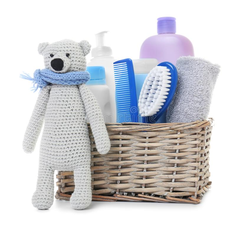 Free Wicker Basket With Baby Cosmetic Products And Knitted Bear Isolated Stock Photos - 145025663