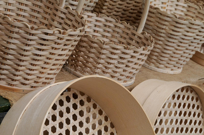 Wicker baskets and sieves. Handmade wicker baskets and sieves at open market stock images