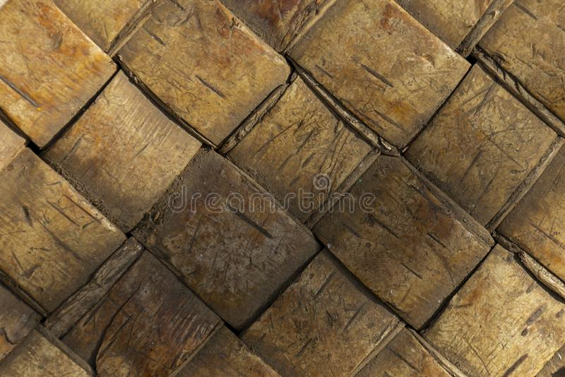 Wicker birch bark. Abstract background for design. The concept of folk art from natural natural materials stock images