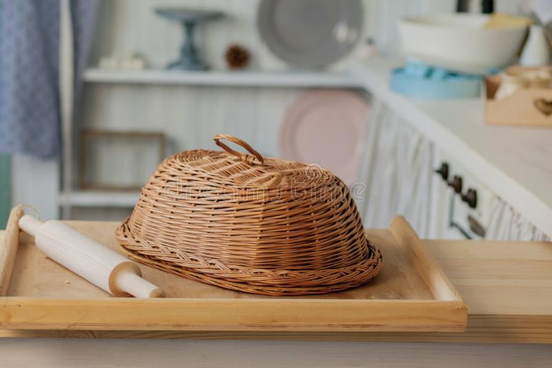 Wicker breadbasket on kitchen table at the photo studio.  royalty free stock image
