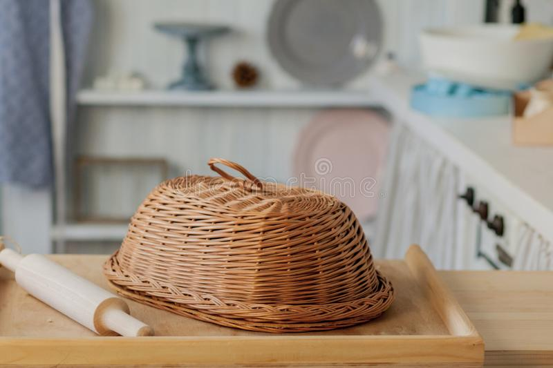 Wicker breadbasket on kitchen table at the photo studio.  stock images