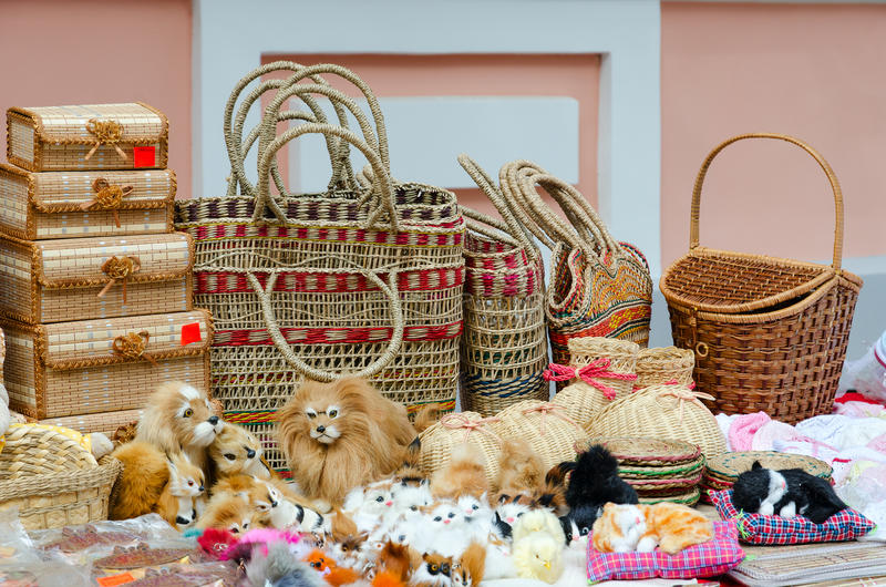 Wicker caskets, baskets, stuffed toys. Street trade on Slavonic Bazaar in Vitebsk. Wicker caskets, baskets, stuffed toys stock photo