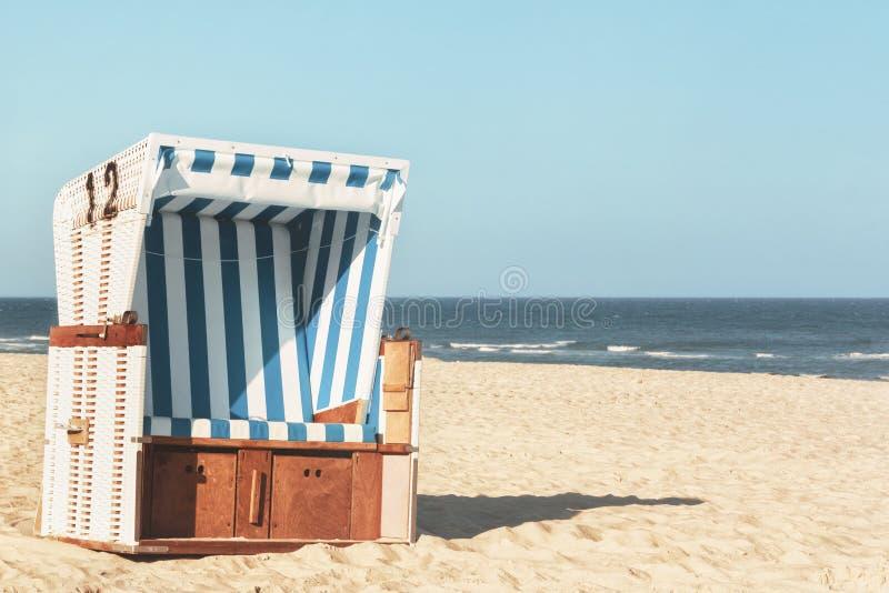 Wicker chair at the beach on Sylt island. Sunny beach day stock photos