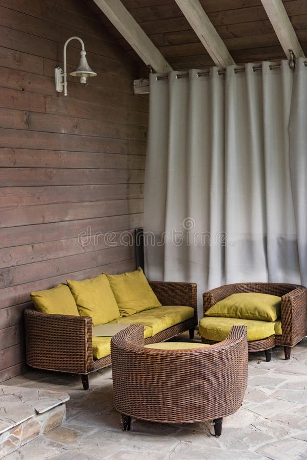 wicker chairs and sofa with pillows on terrace royalty free stock photography