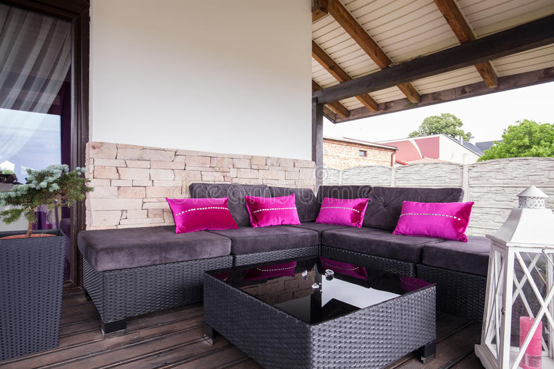 Wicker couch on the terrace. Of the house royalty free stock photos